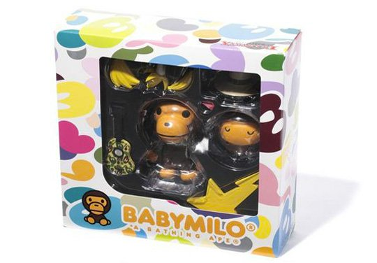 Baby Milo Revoltech Yamaguchi Figure - Camo Version figure by Bape, produced by Revoltech. Packaging.