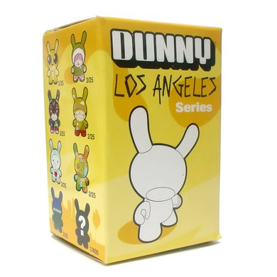 Gary Baseman Gold Dunny figure by Gary Baseman, produced by Kidrobot. Packaging.