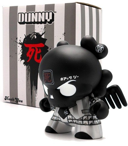 "Black Skullhead 8"" Dunny figure by Huck Gee, produced by Kidrobot. Packaging."