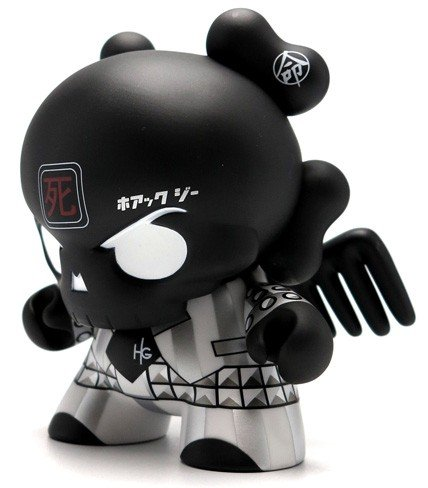 "Black Skullhead 8"" Dunny figure by Huck Gee, produced by Kidrobot. Front view."