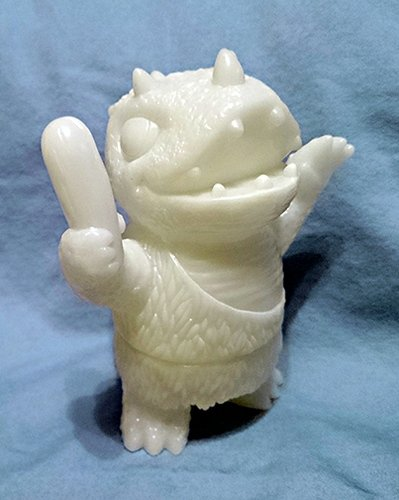 Caveman Dinosaur - Unpainted Glow figure by Josh Herbolsheimer, produced by Super7. Front view.