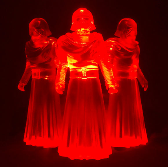 Counterfeit- Clear Red figure by David Healey, produced by Healeymade. Front view.