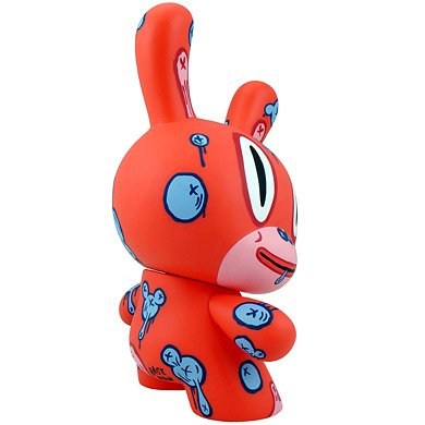 RED MOD figure by Gary Baseman, produced by Kidrobot. Side view.