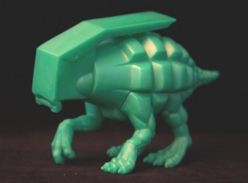 Dinogrenade figure by Ron English, produced by Popaganda. Side view.