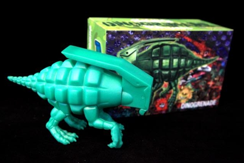 Dinogrenade figure by Ron English, produced by Popaganda. Packaging.
