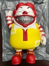 mc supersized grin platinum figure by Ron English. Front view.
