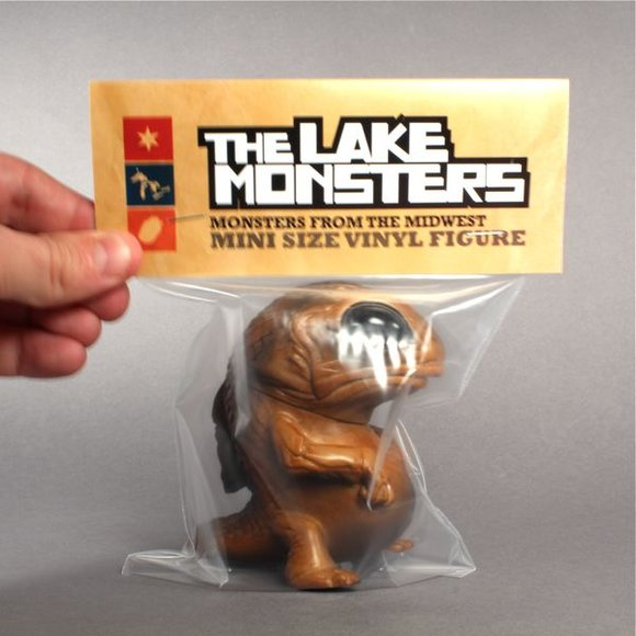 Mud Puddle Snybora figure by Chris Ryniak, produced by Squibbles Ink + Rotofugi. Packaging.