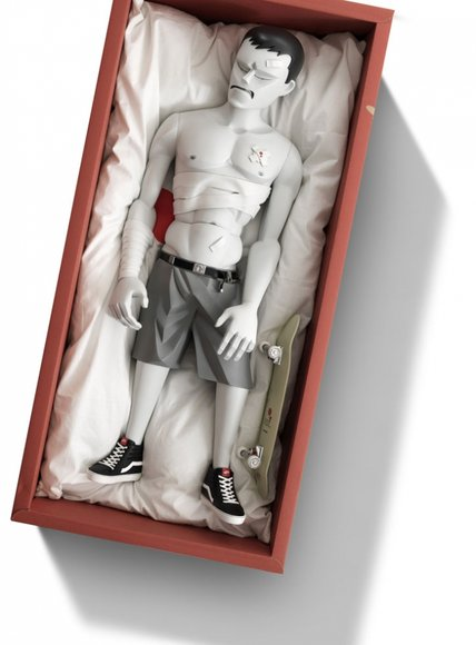 Pain 1:3 figure by Mark Landwehr, produced by Coarsetoys. Packaging.
