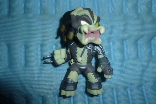 Predator figure, produced by Funko. Front view.