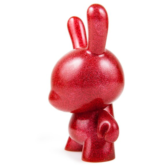 Red Chroma figure, produced by Kidrobot. Side view.