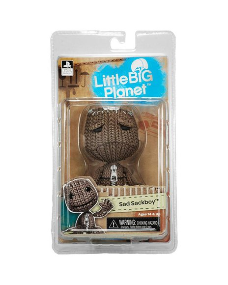 Sad Sackboy figure by Mark Healey And Dave Smith, produced by Neca. Packaging.