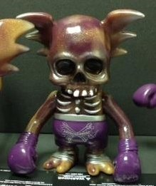 The GRIM purple haze SKULL WING figure by Pushead, produced by Secret Base. Front view.