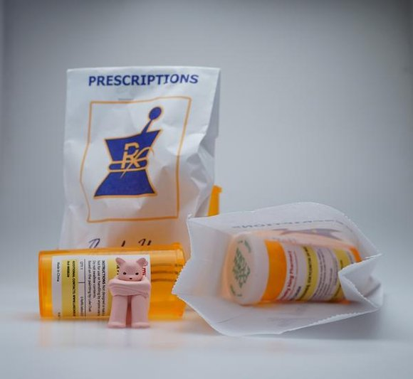 The Prisoner - Oxycontin figure by Luke Chueh, produced by Munky King. Packaging.