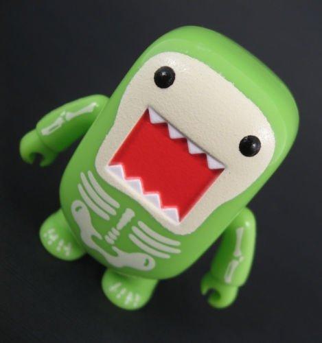 Radioactivity Skeleton GID Domo Qee figure by Dark Horse Comics, produced by Toy2R. Front view.