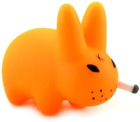 Smorkin Labbit - Fluorescent Orange figure by Frank Kozik, produced by Kidrobot. Front view.