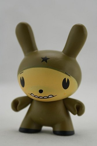 Star Head Olive figure by Dalek, produced by Kidrobot. Front view.
