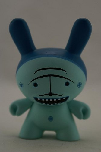 Moustache Blue figure by Dalek, produced by Kidrobot. Front view.