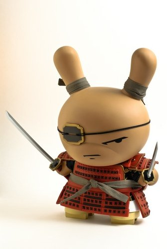 Red Shogun Dunny figure by Huck Gee, produced by Kidrobot. Front view.