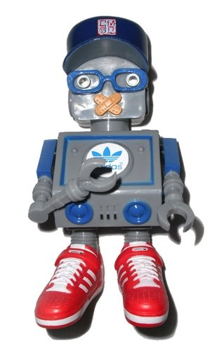 DJ Tommy figure by Cmd, produced by Adidas. Front view.