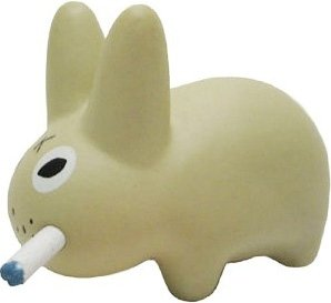 Beige Labbit figure by Frank Kozik, produced by Kidrobot. Front view.