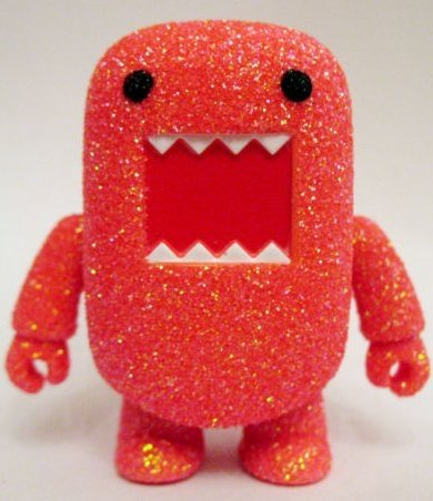 Orange Glitter Domo figure by Dark Horse Comics, produced by Toy2R. Front view.