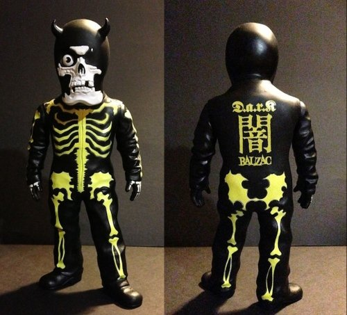 D.a.r.k Skullman (yellow) figure by Balzac, produced by Evilegend 13. Front view.