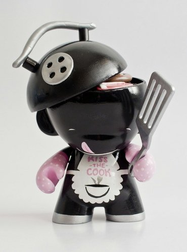 Kiss the cook figure by Emma Cook, produced by Kidrobot. Front view.