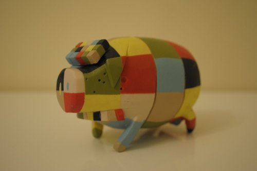 The Pig Chase figure by Michael Lau, produced by Crazysmiles. Front view.