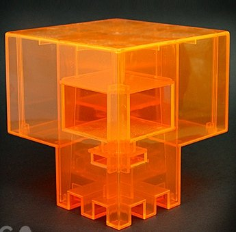Clear Orange Sqube figure by Ferg, produced by Jamungo. Front view.