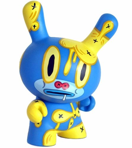 Baseman (Blue) figure by Gary Baseman, produced by Kidrobot. Front view.