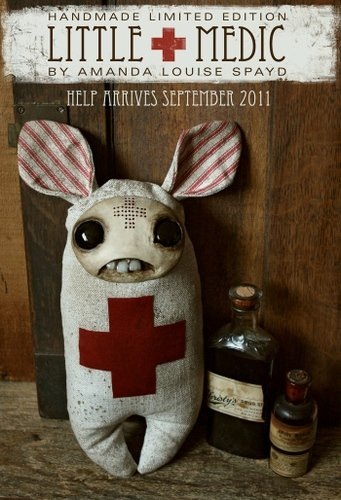 Little medic figure by Amanda Louise Spayd. Front view.
