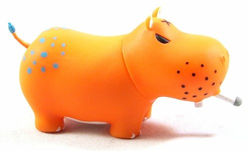 Orange Smoothie Potamus figure by Frank Kozik, produced by Toy2R. Front view.
