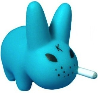 Teal Smorkin Labbit figure by Frank Kozik, produced by Kidrobot. Front view.
