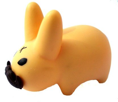 Mustache Labbit figure by Frank Kozik, produced by Kidrobot. Front view.
