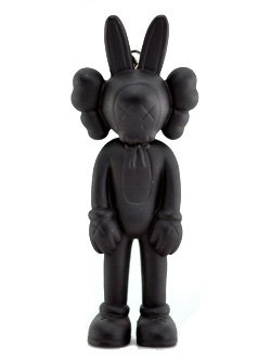 Accomplice Keychain - Black figure by Kaws, produced by Medicom Toy. Front view.