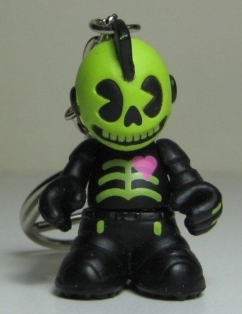 Glow in the Dark Skully  figure, produced by Kidrobot. Front view.