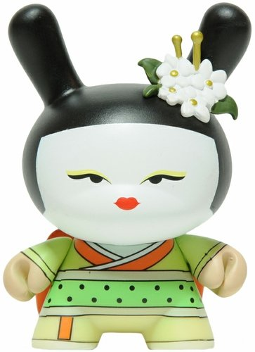 Yellow Geisha figure by Huck Gee, produced by Kidrobot. Front view.
