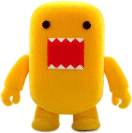 Yellow Flocked Domo Qee figure by Dark Horse Comics, produced by Toy2R. Front view.
