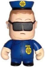 Officer Barbrady figure by Matt Stone & Trey Parker, produced by Kidrobot. Front view.