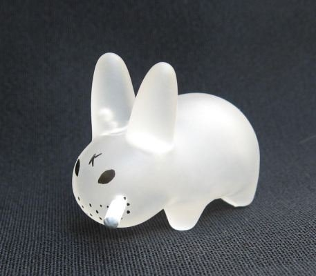 Mini Smorkin Labbit - Clear figure by Frank Kozik, produced by Kidrobot. Front view.
