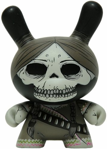 Adelita - Mono figure by Oscar Mar, produced by Kidrobot. Front view.