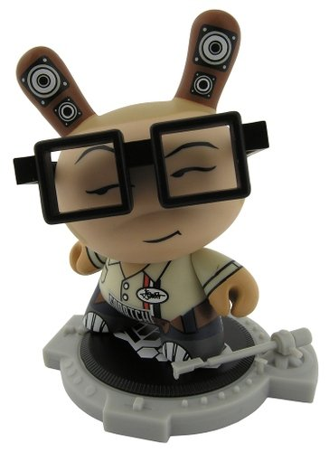 DJ Qbert - Tan figure by Huck Gee, produced by Kidrobot. Front view.