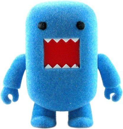 Flocked Blue Domo Qee figure by Dark Horse Comics, produced by Toy2R. Front view.