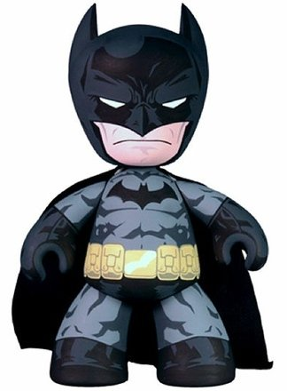 Batman figure by Dc Comics, produced by Mezco Toyz. Front view.