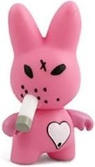 Pink Bunny  figure by Frank Kozik, produced by Kidrobot. Front view.