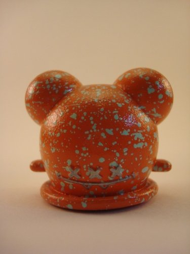Orange Sherbert Buff figure by Brandon Morrow, produced by Mindstyle. Front view.
