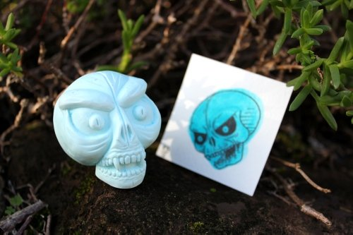 Skull Tattoos - Scary Skull - Blue figure by Double Haunt. Front view.