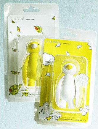 Yellow Ji Ja Bird figure by Mr. Clement. Packaging.
