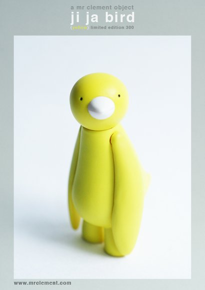 Yellow Ji Ja Bird figure by Mr. Clement. Front view.