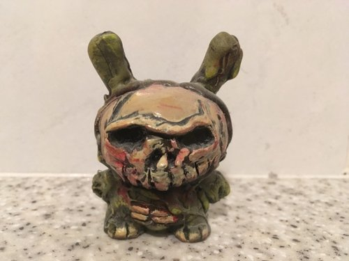 Zombie Dunny figure by Riot68, produced by Self Produced. Front view.